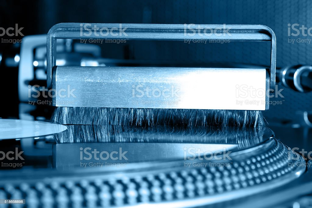 Cleaning  vinyl record stock photo