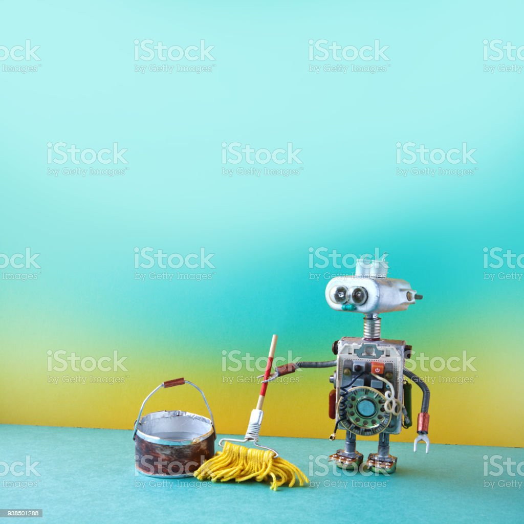 Cleaning washing room service concept. Robot janitor with yellow mop, bucket of water, sweeping floor. Creative design toy cyborg, green yellow apartment. Copy space stock photo