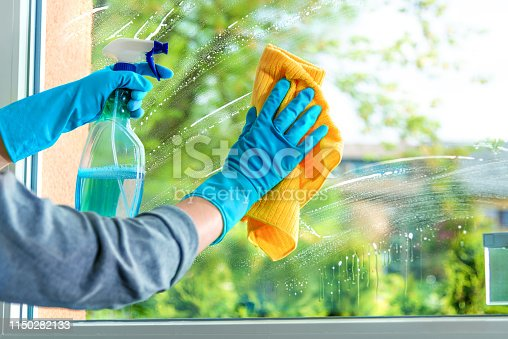 istock Cleaning window pane with detergent 1150282133