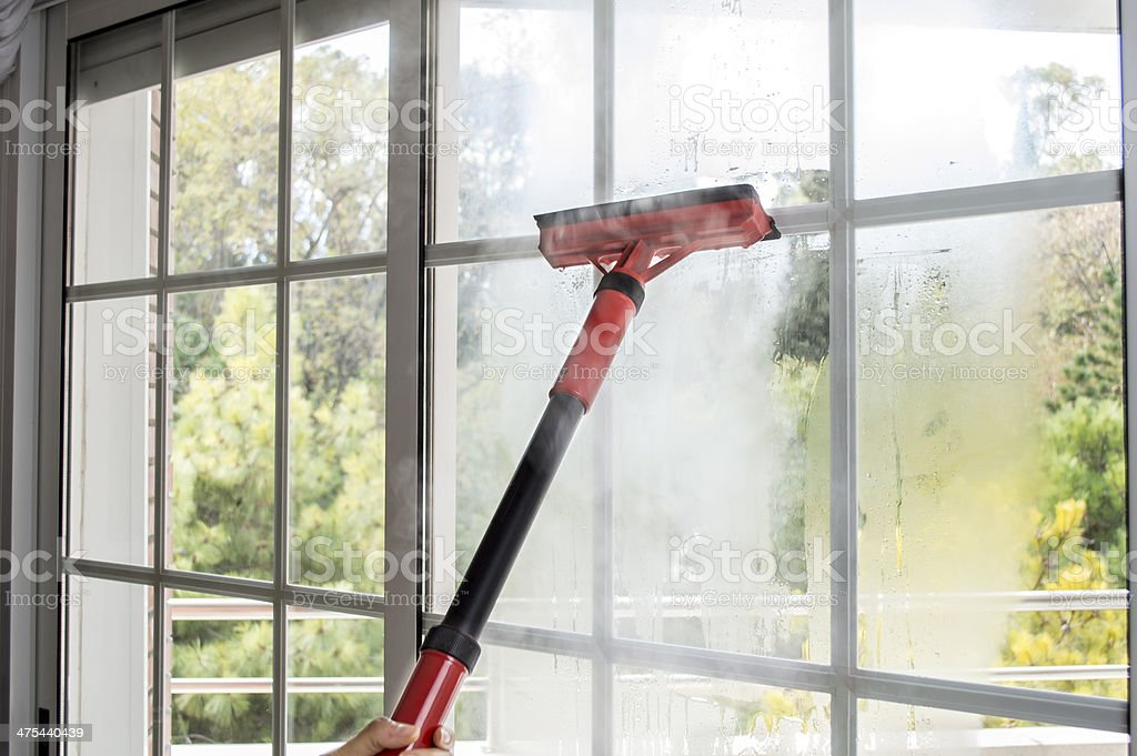 cleaning window with steam stock photo