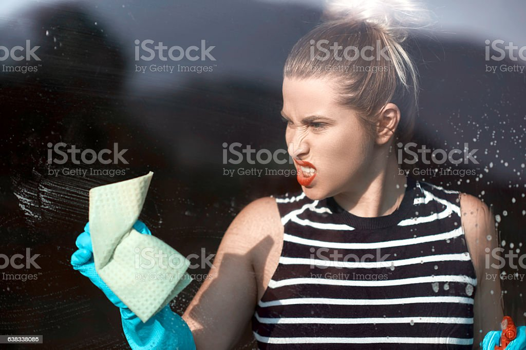 lifestyle and home activities concept, young woman cleaning the dirty...