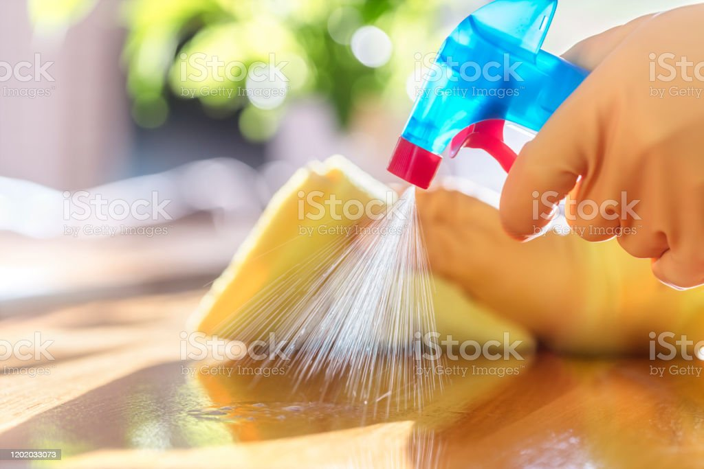 Cleaning with spray detergent, rubber gloves and dish cloth on work surface Cleaning with spray detergent, rubber gloves and dish cloth on work surface concept for hygiene Adult Stock Photo