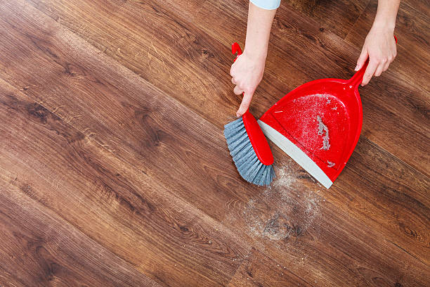 cleaning woman sweeping wooden floor - sweeping stock pictures, royalty-free photos & images