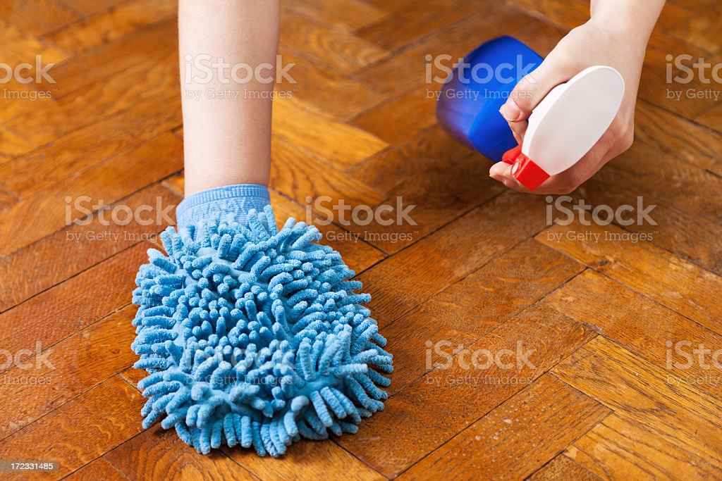 Cleaning wooden floor royalty-free stock photo