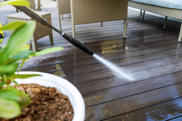 cleaning wooden terrace planks with high pressure washer stock photo