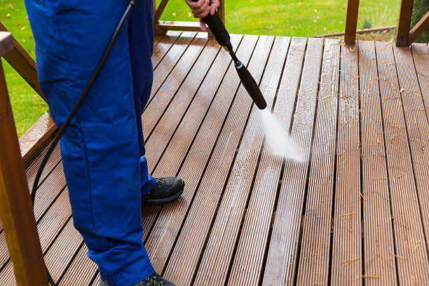 cleaning wooden terrace with high pressure washer - high pressure cleaning stock photos and pictures