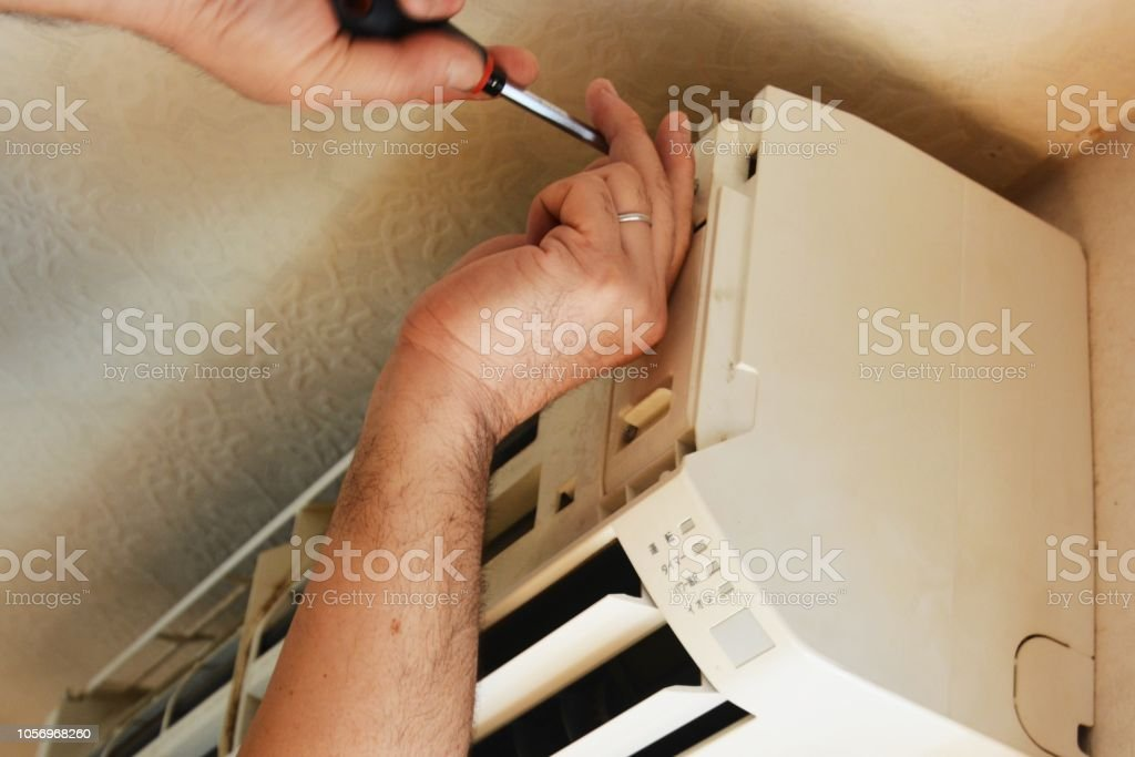 Cleaning work of air conditioner stock photo