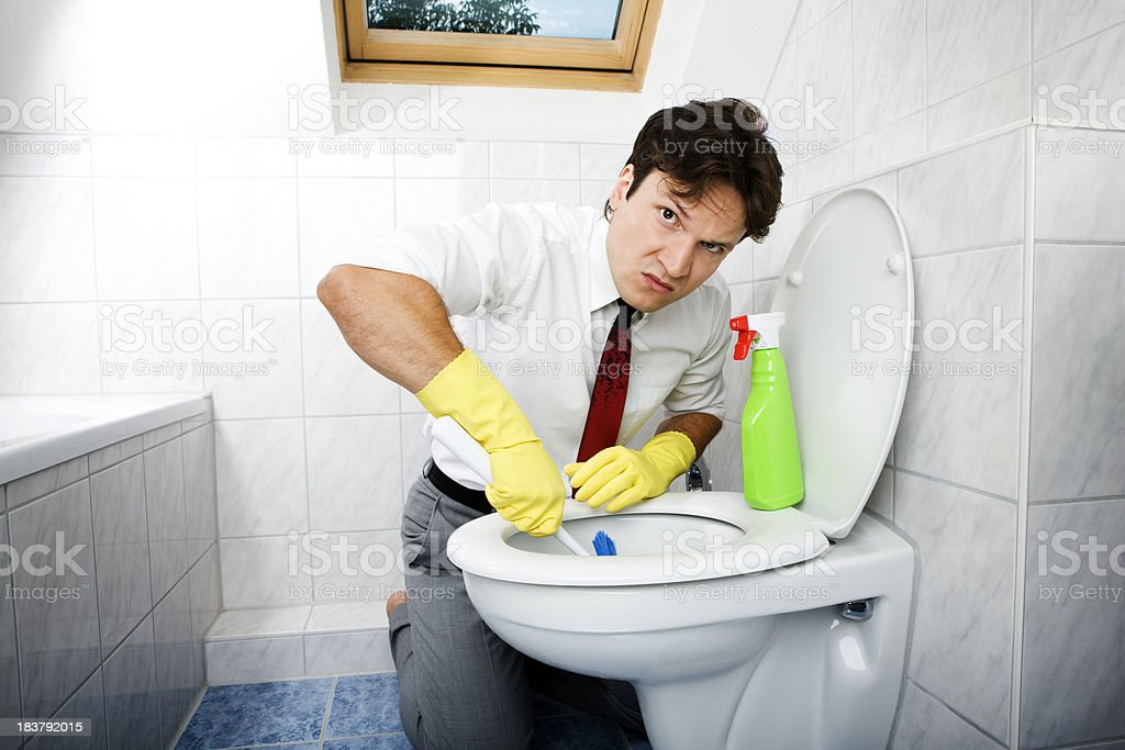 Cleaning young business man in bathroom stock photo more pictures of adult istock for How to professionally clean a bathroom