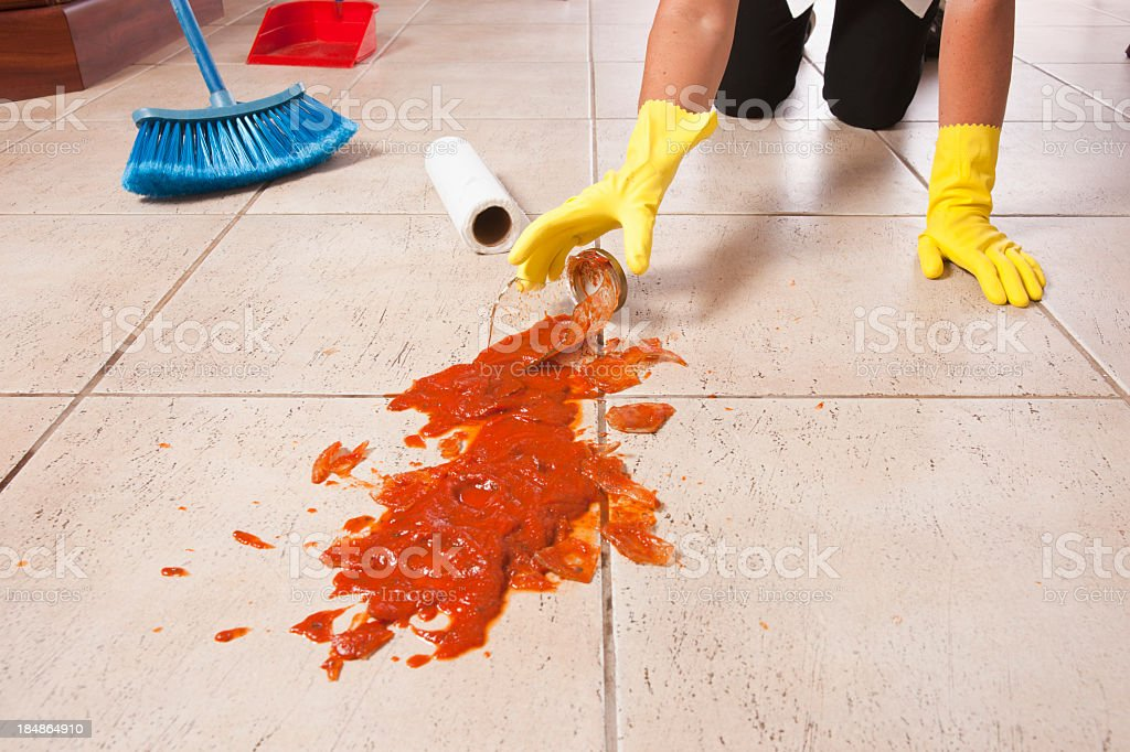 Cleaning-up a spaghetti jar accident stock photo
