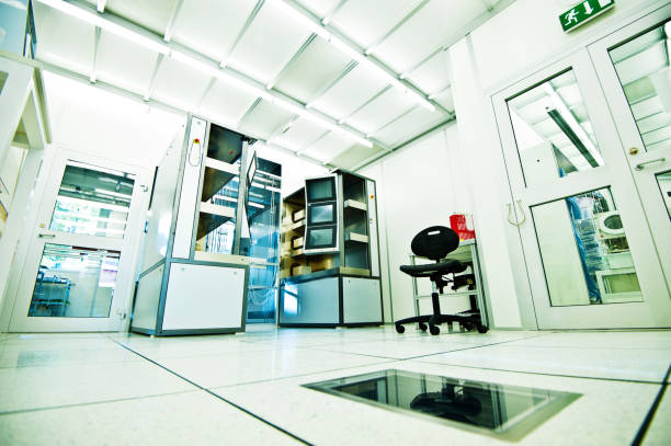 A Cleanroom Wide angle image of a semiconductor fabrication cleanroom cleanroom stock pictures, royalty-free photos & images