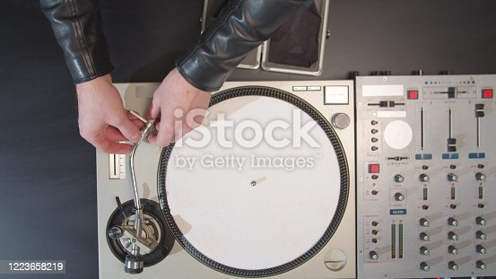 istock DJ cleans and connects parts of the turntable 1223658219