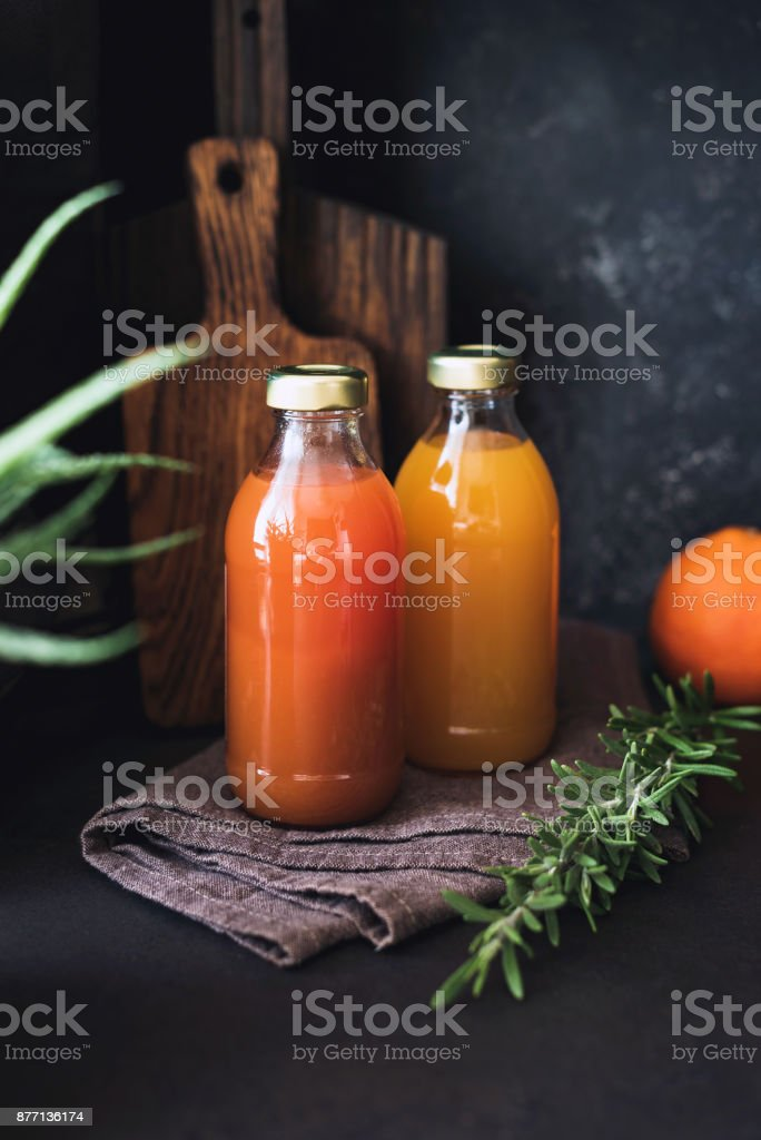 Cleansing fresh citrus juices in bottles stock photo