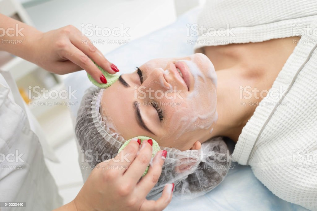 Cleansing peeling at the beauty salon. stock photo