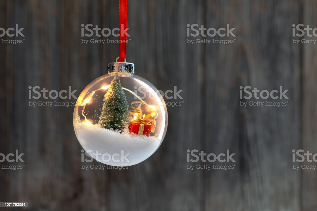 Clear Ball Ornament  with christmas tree,  small gift and christmas light inside. stock photo