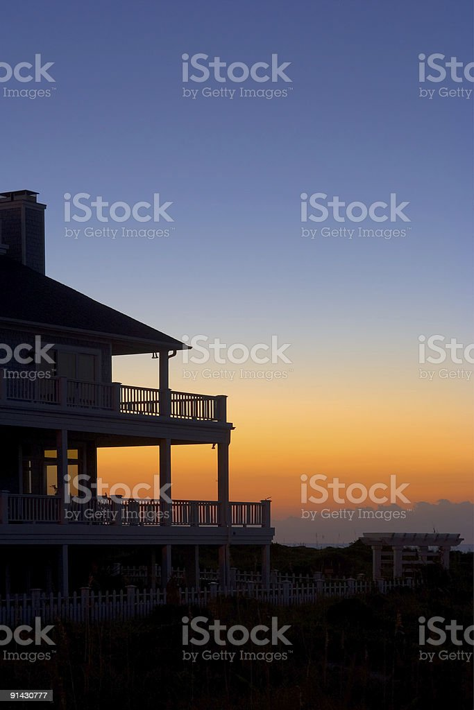 Clear blue orange sky and front porch stock photo