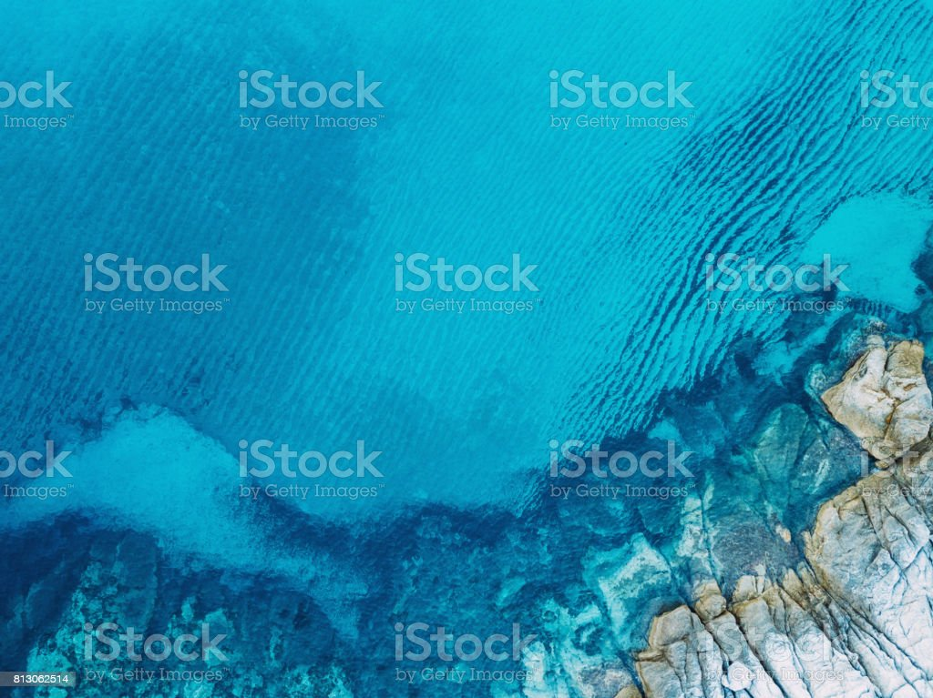 Clear blue sea and rocks stock photo