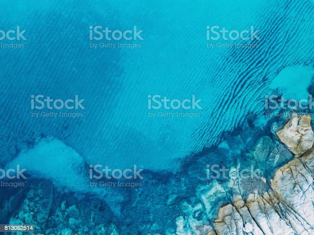Photo of Clear blue sea and rocks