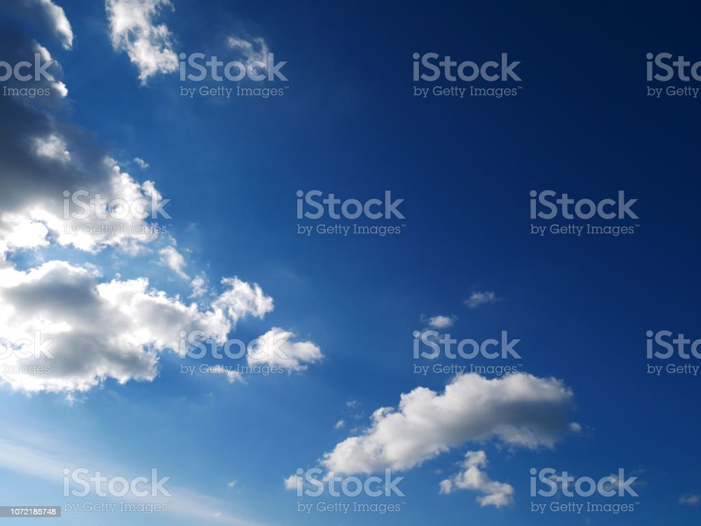 Clear blue sky and white clouds background stock photo