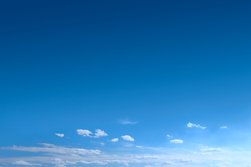 A blue sky with clouds at the bottom of image, giving much unimpeded space for copy - Canon 5D MarkII.