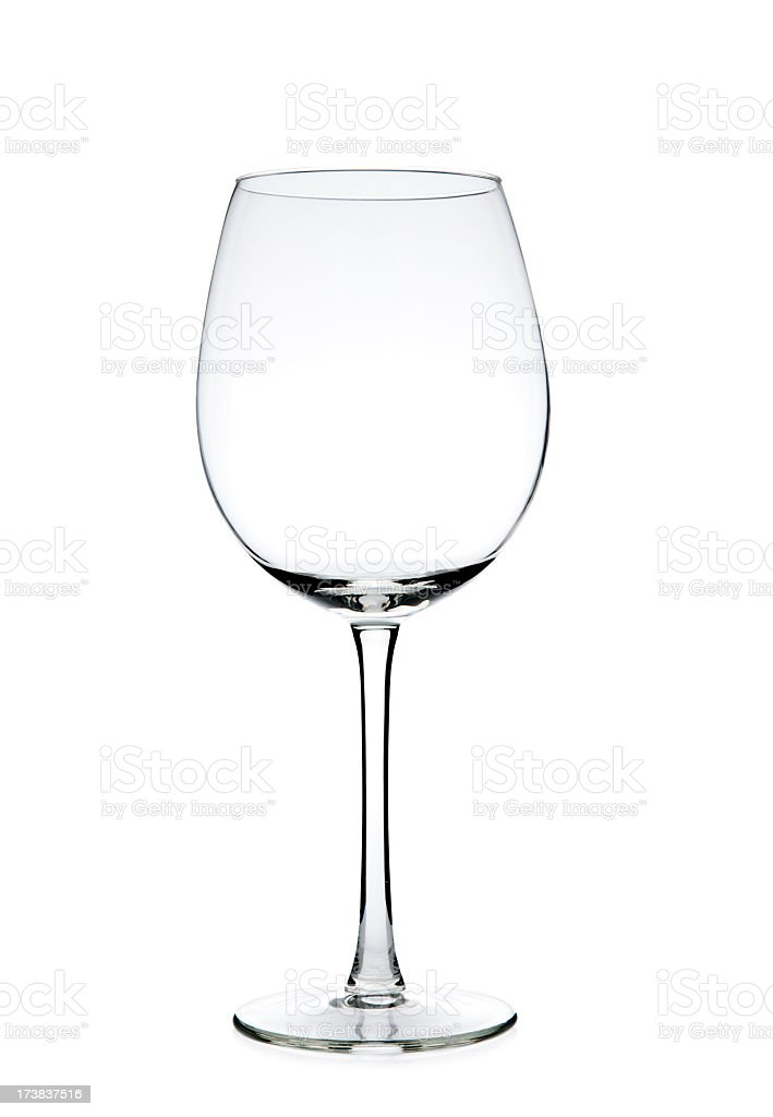 Clear empty wine glass against a white background stock photo