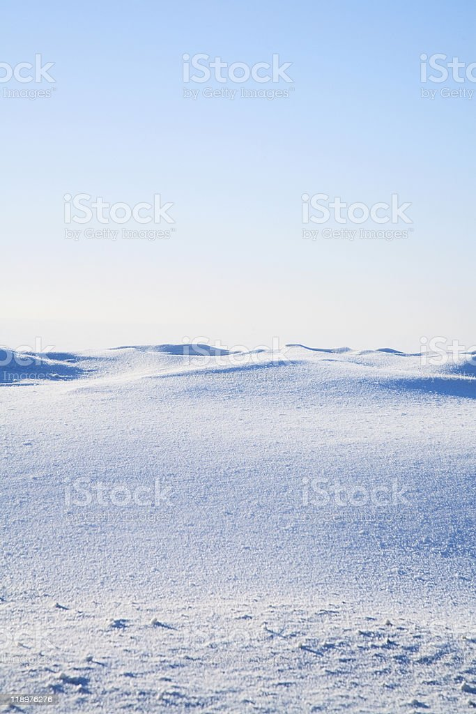 Clear frozen and snowy tundra on a beautiful morning stock photo