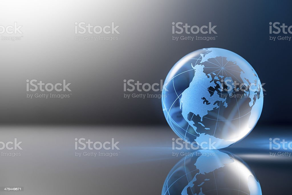 Clear glass globe on gray table backround. stock photo