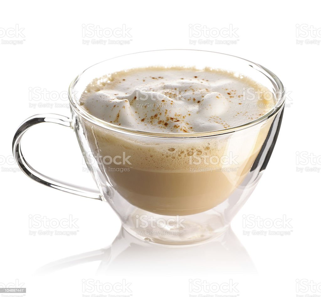 Clear glass of cappuccino top with whip cream and cinnamon royalty-free stock photo