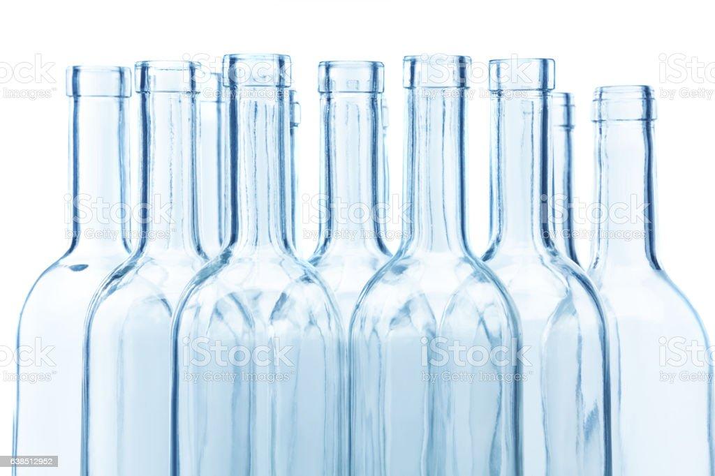 Clear glass wine bottles' necks on white stock photo
