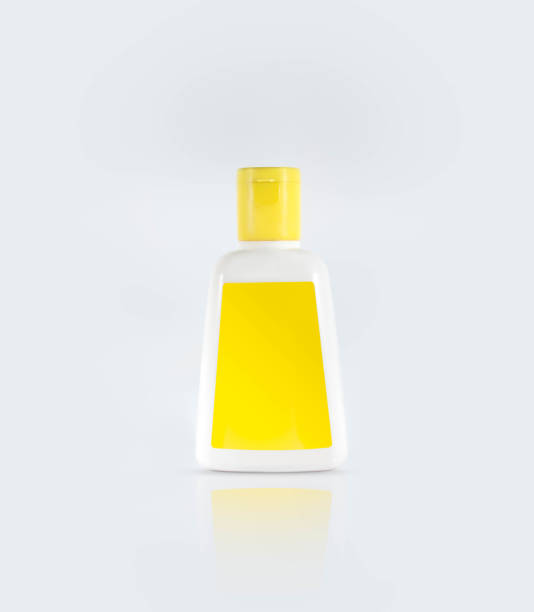 Clear hand sanitizer in a clear pump bottle isolated on a white background. Hand sanitizer is used for killing germs, bacteria and viruses, some of which can cause H1N1 flu or swine flu. stock photo