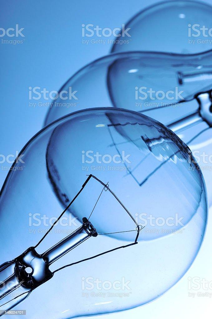 Clear Light Bulbs Isolated On Light Blue Stock Photo