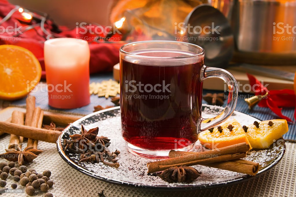 Clear mug of mulled wine with associated fruits and spices royalty-free stock photo