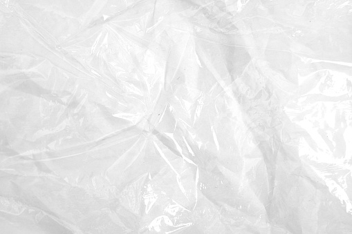 Clear plastic texture with white color. Nylon polythene wrap. Plastic free lifestyle, ecology pollution . High quality photo