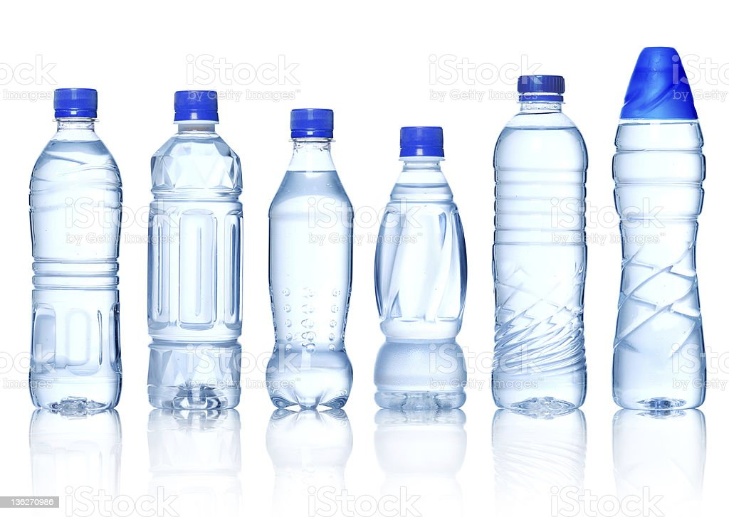 Clear plastic water bottles with blue caps stock photo