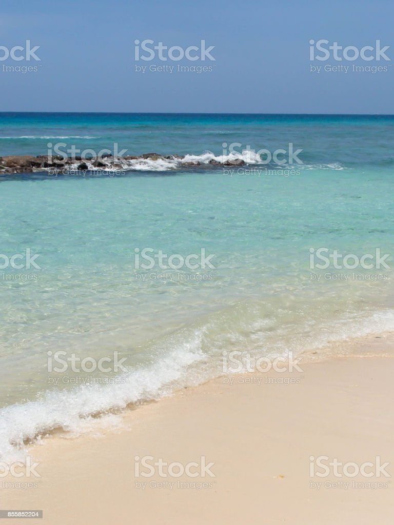 Clear sea and white sand beach in paradisiac island stock photo