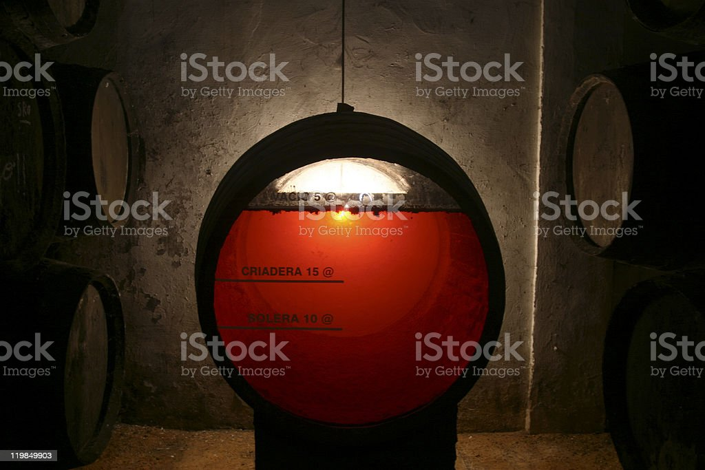 Clear sherry wine barrel in old brown cellar stock photo