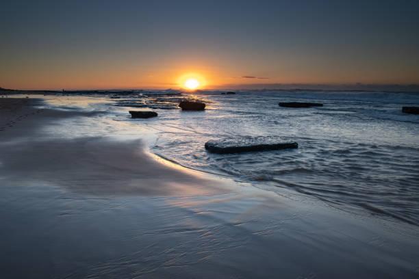Clear Skies Sunrise Seascape stock photo