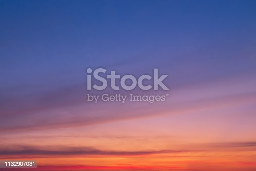 646012098istockphoto Clear sky with pink horizon and blue atmosphere. Smooth pink blue gradient of sky. Background of beginning of day with copy space 1132907031