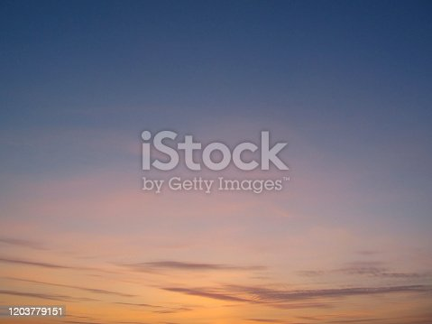 917116520 istock photo Clear sky with small clouds on the horizon at sunset 1203779151