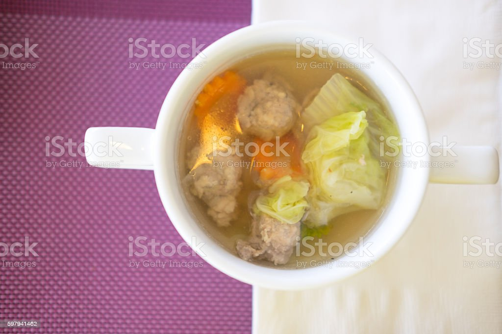 clear soup with pork in white bowl foto royalty-free