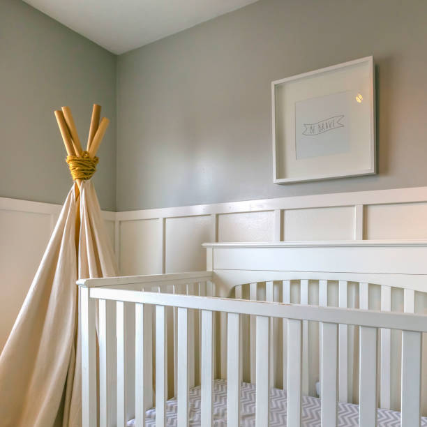 Clear Square Interior of a room for children with white wooden crib and play teepee stock photo