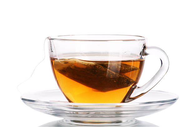 Clear tea cup with teabag inside stock photo