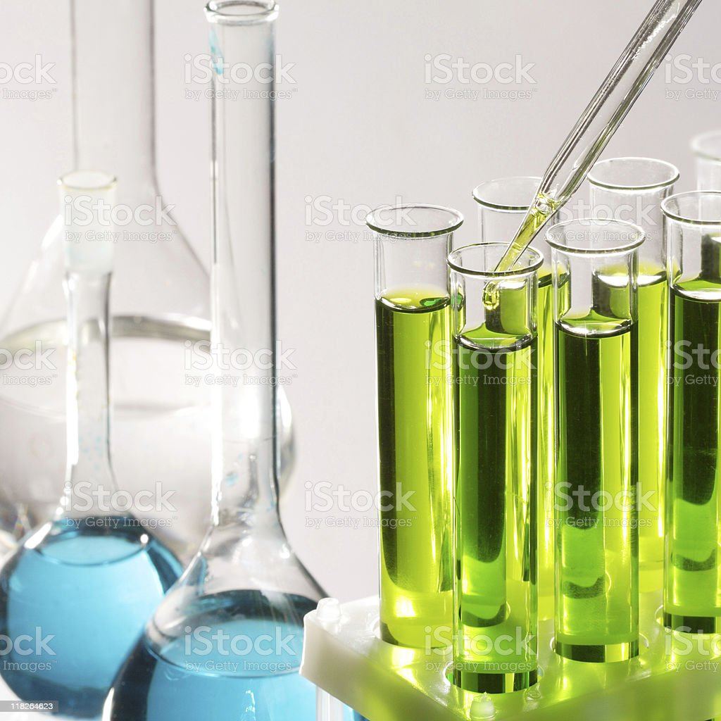 Clear test tubes with blue and green liquids inside royalty-free stock photo