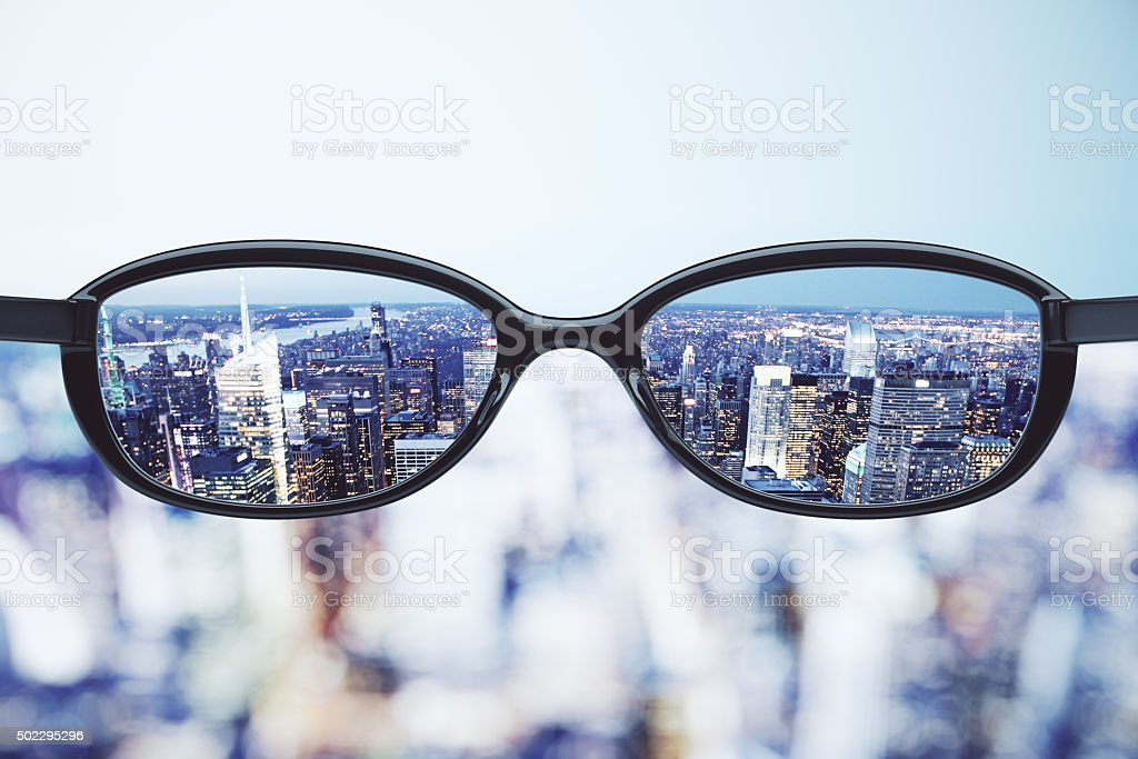 Clear vision concept with eyeglasses and night megapolis city ba stock photo