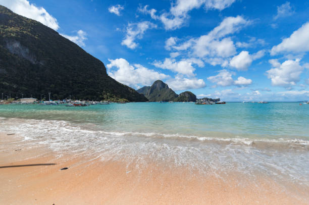Clear water and a cloudy sky in El Nido beach, Palawan, Philippines stock photo