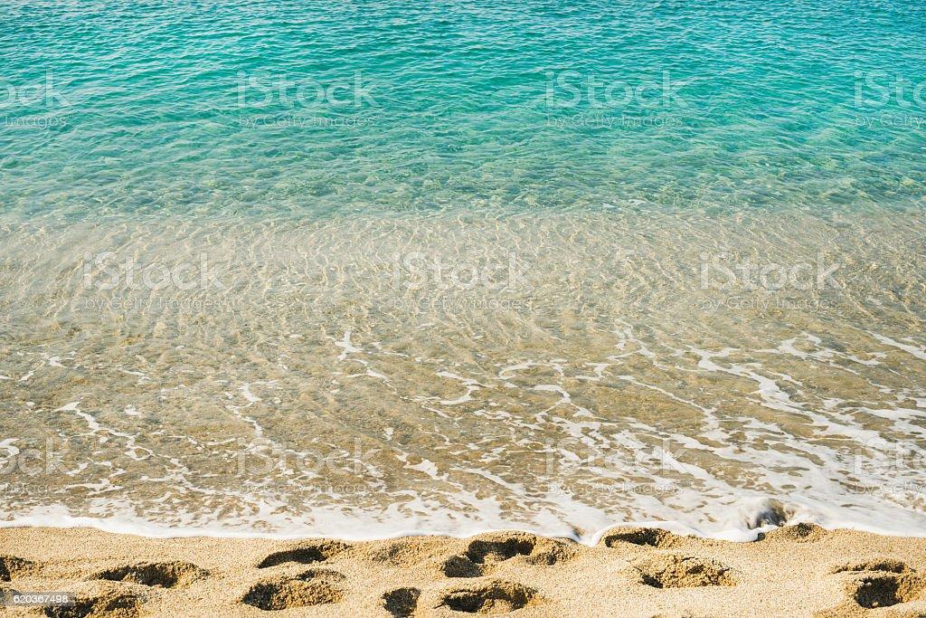 Clear water and footprints at Cleopatra beach, Alanya, Turkey zbiór zdjęć royalty-free