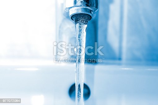 Clear water flows from the faucet