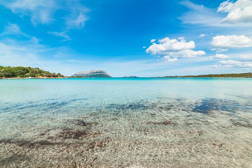 Helder Water In Porto Istana Wal In Costa Smeralda Stockfoto en meer beelden van Blauw