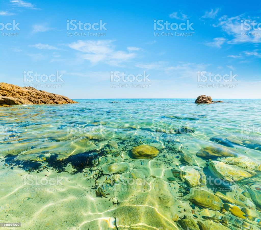 Clear water in Santa Giusta beach Lizenzfreies stock-foto