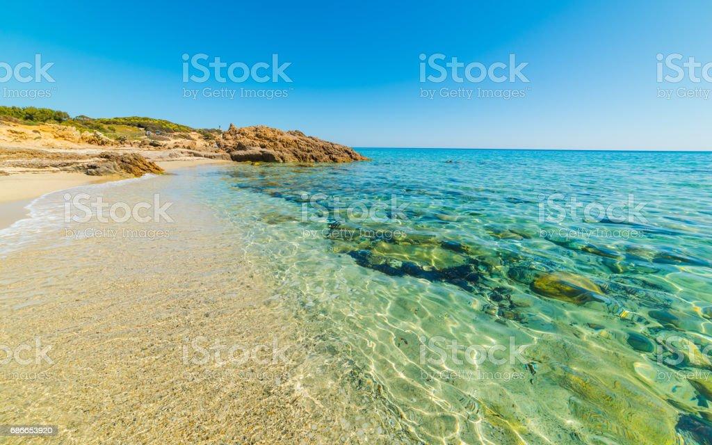 Clear water in Santa Giusta shore royalty-free stock photo