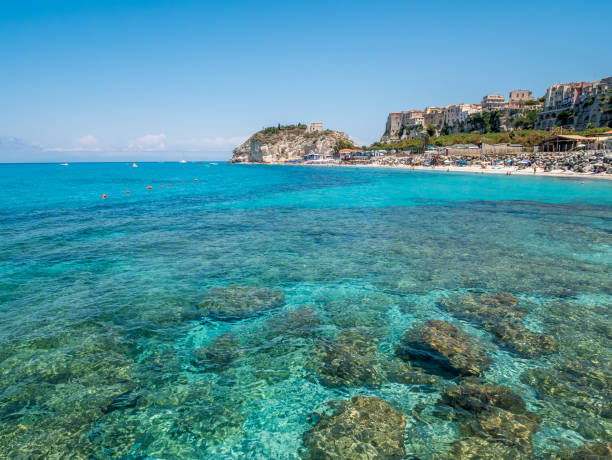 Clear water of Tropea beach in Italy. stock photo